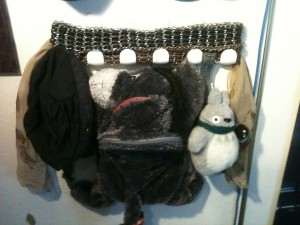 Eeyore, Totoro, a hat, a scarf, and two chain belts.