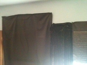 Closeup of Sheet, Shawl, and Pillowcase being used as curtains.